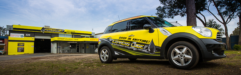 The Express Lube Gosford service centre with an Express Lube branded car parked out the front.